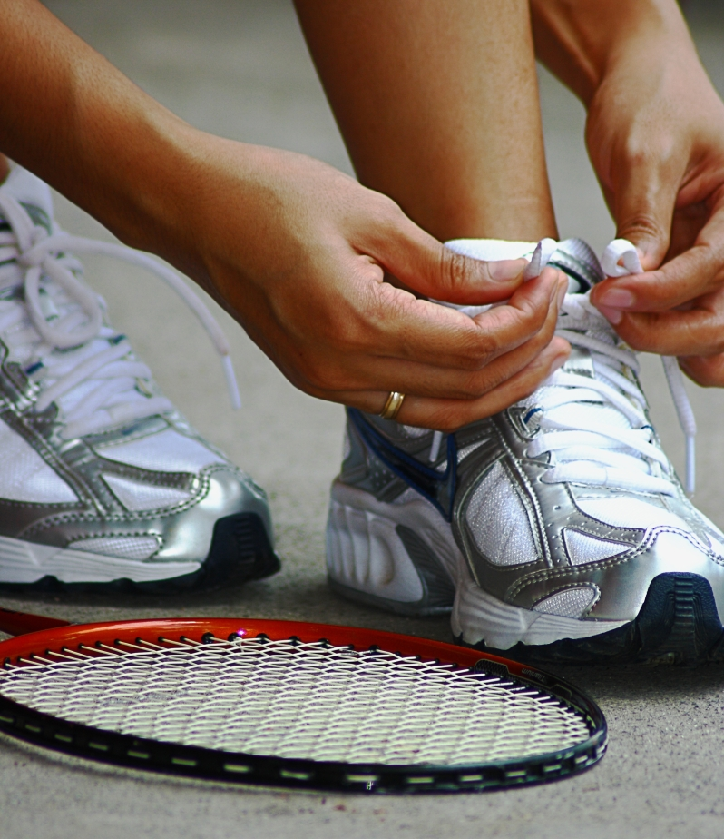 tying-shoe-laces-ready-for-a-game-of-badminton_fJ2v3NDd.jpg