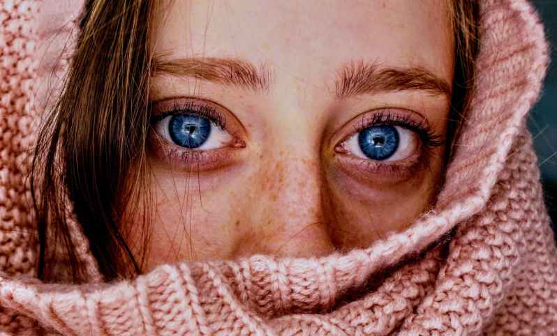 woman with blue eyes wrapped in a pink cloth